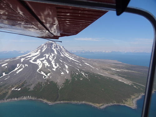Augustine Volcano, here not active, but upon our return displaying a column of steam...most recentlyactive four years ago...pilot aimed at it from Homer, then turned SW while along side of it, towards the Bear Camp...